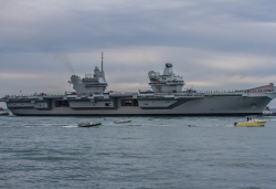 Side view of HMS Queen Elizabeth with crew on deck
